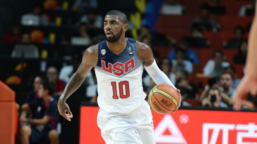MADRID, SPAIN - SEPTEMBER 14: Kyrie Irving #10 of the USA Men's National Team drives against the Serbia National Team during the 2014 FIBA World Cup Finals at Palacio de Deportes on September 14, 2014 in Madrid, Spain. NOTE TO USER: User expressly acknowledges and agrees that, by downloading and/or using this Photograph, user is consenting to the terms and conditions of the Getty Images License Agreement. Mandatory Copyright Notice: Copyright 2014 NBAE (Photo by Garrett Ellwood/NBAE via Getty Images)