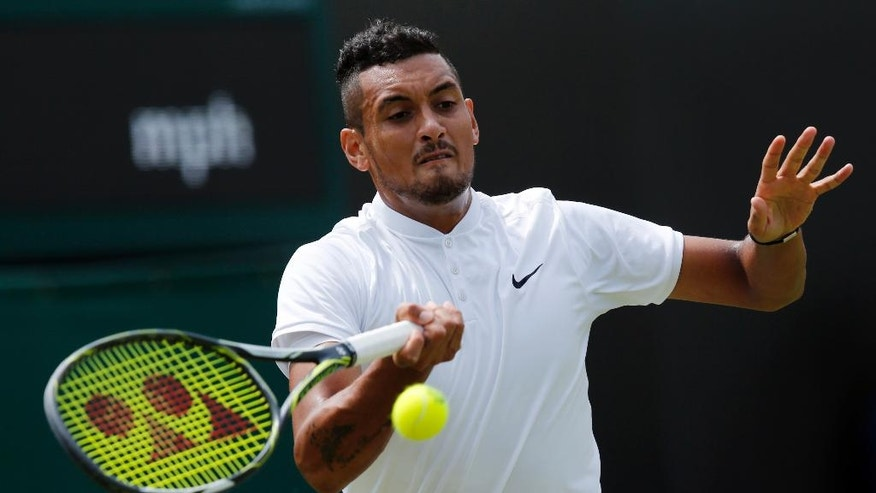 Nick Kyrgios of Australia plays a return to Radek Stepanek of the Czech Republic during their men's singles match on day two of the Wimbledon Tennis Championships in London, Tuesday, June 28, 2016. (AP Photo/Ben Curtis)