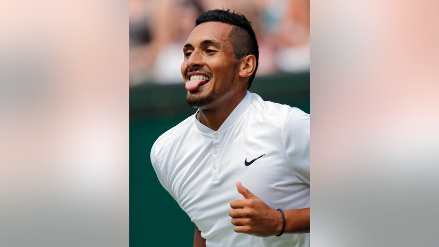 Nick Kyrgios of Australia celebrates a point against Radek Stepanek of the Czech Republic during their men's singles match on day two of the Wimbledon Tennis Championships in London, Tuesday, June 28, 2016. (AP Photo/Ben Curtis)