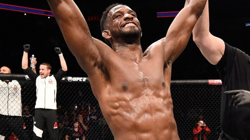 MONTERREY, MEXICO - NOVEMBER 21: Neil Magny of the United States celebrates after his split-decision victory over Kelvin Gastelum of the United States in their welterweight bout during the UFC Fight Night event at Arena Monterrey on November 21, 2015 in Monterrey, Mexico. (Photo by Jeff Bottari/Zuffa LLC/Zuffa LLC via Getty Images)