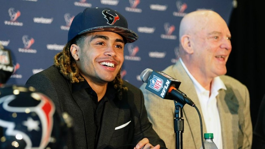 Houston Texans top NFL football draft pick Will Fuller, left, and owner Bob McNair smile at a press conference Friday, April 29, 2016, in Houston. The wide receiver played football for Notre Dame. (AP Photo/Pat Sullivan)