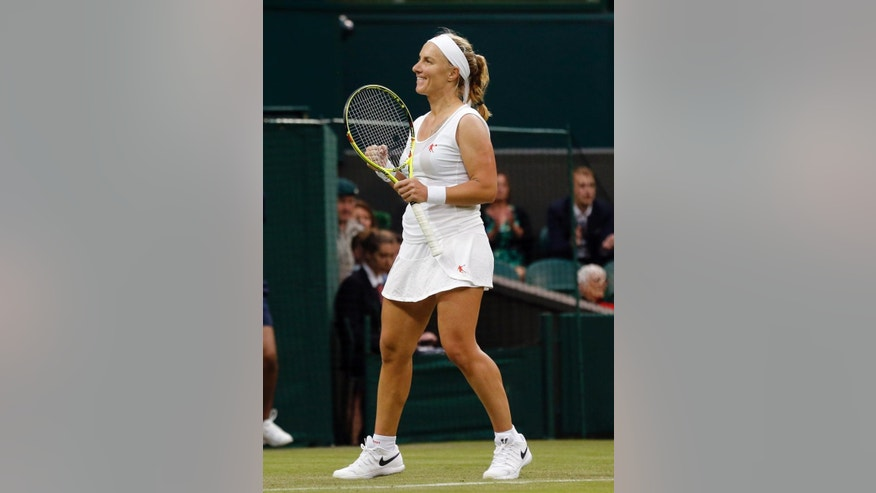 Svetlana Kuznetsova of Russia celebrates after beating Caroline Wozniacki of Denmark during their women's singles match on day two of the Wimbledon Tennis Championships in London, Tuesday, June 28, 2016. (AP Photo/Ben Curtis)