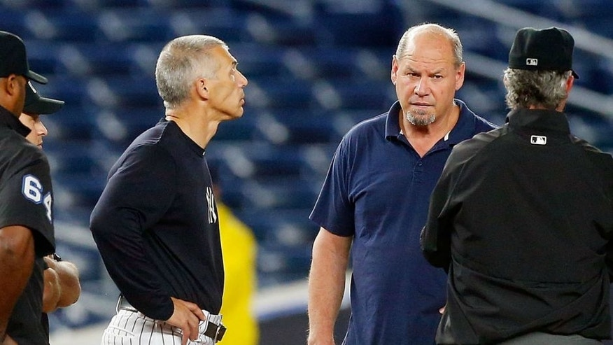 <p>against the at Yankee Stadium on June 27, 2016 in the Bronx borough of New York City.,NEW YORK, NY - JUNE 27: Managers Joe Girardi #28 of the New York Yankees and Jeff Banister #28 of the Texas Rangers inspect the field with the umpires, grounds crew and stadium officials after a lengthy rain delay at Yankee Stadium on June 27, 2016 in the Bronx borough of New York City. (Photo by Jim McIsaac/Getty Images)</p>