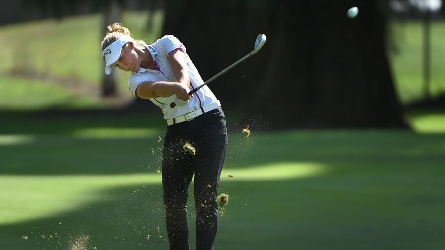 FILE- In this Aug. 15, 2015, file photo, Brooke Henderson, of Canada, hits her approach shot on the 18th hole during the third round of the LPGA Cambia Portland Classic golf tournament in Portland, Ore. Henderson has come a long way since her win last year in Portland. She's ranked No. 2 in the world and has a major victory as she looks to defend her title at the Portland Classic. (AP Photo/Steve Dykes, File)