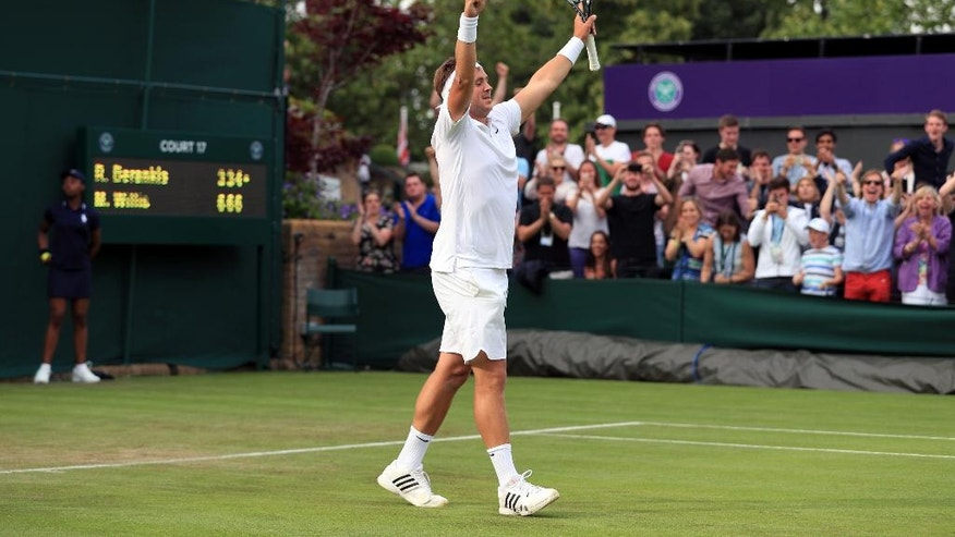 Britain's Marcus Willis, the world number 772, celebrates his victory over 54th-ranked Lithuania's Ricardas Berankis 6-3 6-3 6-4 on day one of the Wimbledon Tennis Championships in London, Monday, June 27, 2016. (Adam Davy/PA via AP) UNITED KINGDOM OUT