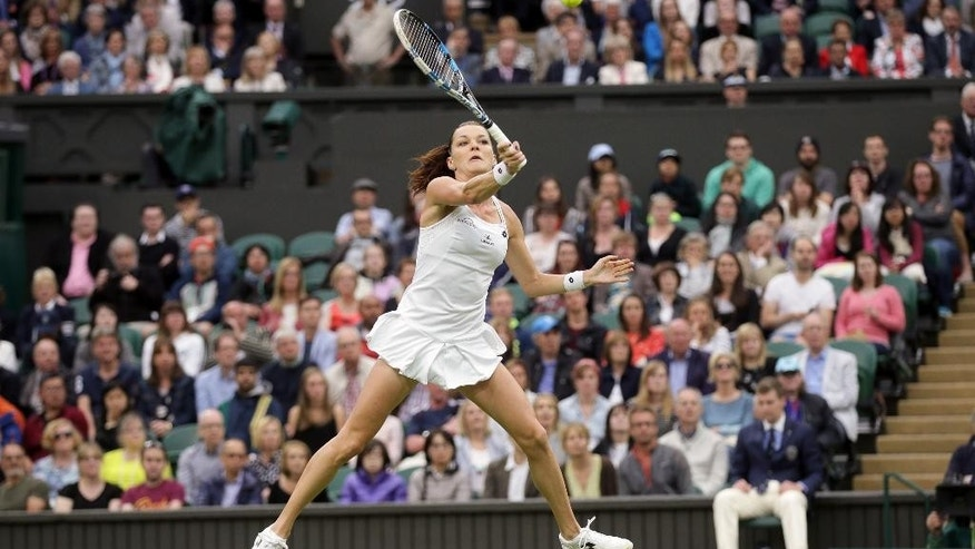 Agnieszka Radwanska of Poland returns to Kateryna Kozlova of the Ukraine during their women's singles match on day three of the Wimbledon Tennis Championships in London, Wednesday, June 29, 2016. (AP Photo/Tim Ireland)