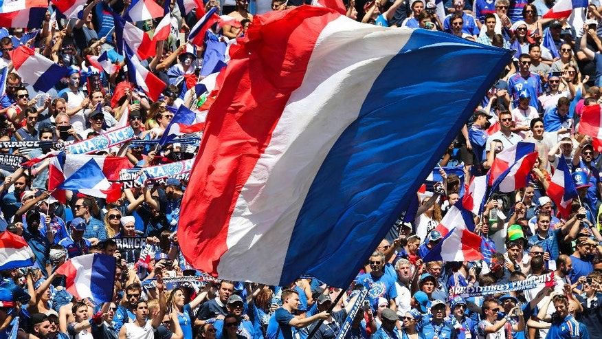 France supporters wave flags during the Euro 2016 round of 16 soccer match between France and Ireland, at the Grand Stade in Decines-­Charpieu, near Lyon, France, Sunday, June 26, 2016. (AP Photo/Thanassis Stavrakis)