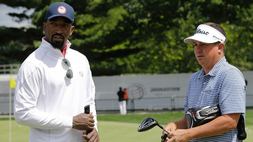 Cleveland Cavaliers' J.R. Smith, left, talks with Jason Dufner during the practice round of the Bridgestone Invitational golf tournament at Firestone Country Club, Wednesday, June 29, 2016, in Akron, Ohio. (AP Photo/Tony Dejak)