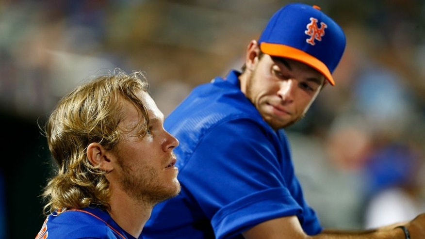 NEW YORK, NY - JULY 10: Pitchers Noah Syndergaard #34, talks with Steven Matz of the New York Mets in the dugout during a game against the Arizona Diamondbacks on July 10, 2015 at Citi Field in the Flushing neighborhood of the Queens borough of New York City. (Photo by Rich Schultz/Getty Images)