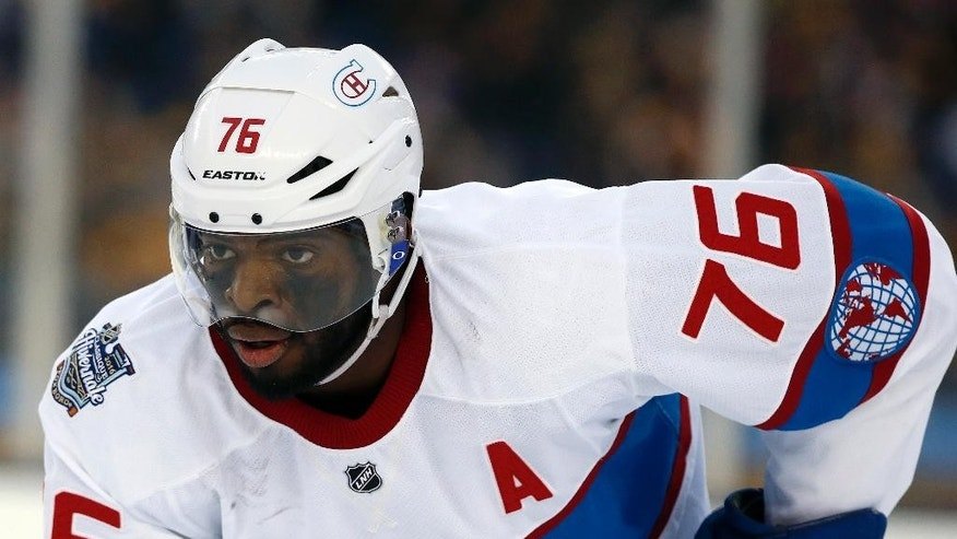 FILE - In this Jan. 1, 2016, file photo, Montreal Canadiens' P.K. Subban (76) watches the action during the second period of the NHL Winter Classic hockey game against the Boston Bruins at Gillette Stadium in Foxborough, Mass. The Nashville Predators pulled off a blockbuster before the start of free agency Wednesday, June 29, 2016,  by acquiring P.K. Subban from the Montreal Canadiens in exchange for Shea Weber, a swap of All-Star defensemen. (AP Photo/Michael Dwyer, File)