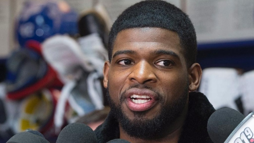 FILE - In this April 11, 2016, file photo, Montreal Canadiens defenseman P.K. Subban talks with reporters during an end of season availability at the team training facility in Brossard, Quebec.  The Nashville Predators pulled off a blockbuster before the start of free agency Wednesday, June 29, 2016,  by acquiring P.K. Subban from the Montreal Canadiens in exchange for Shea Weber, a swap of All-Star defensemen. (Paul Chiasson/The Canadian Press via AP, File)