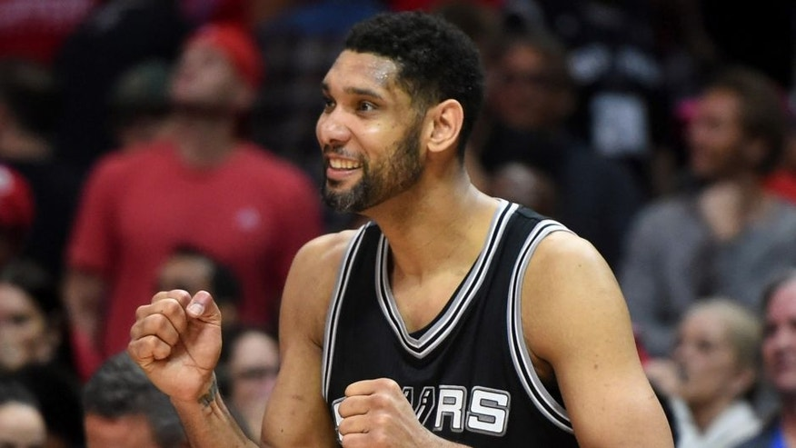 Apr 28, 2015; Los Angeles, CA, USA; San Antonio Spurs forward Tim Duncan (21) reacts in the final seconds against the Los Angeles Clippers in game five of the first round of the NBA Playoffs at Staples Center. The Spurs defeated the Clippers 111-107 to take a 3-2 lead. Mandatory Credit: Kirby Lee-USA TODAY Sports