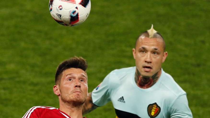 Hungary's Adam Pinter, left, and Belgium's Radja Nainggolan watch the ball during the Euro 2016 round of 16 soccer match between Hungary and Belgium, at the Stadium municipal in Toulouse, France, Sunday, June 26, 2016. (AP Photo/Francois Mori)