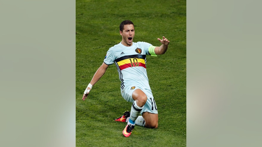 Belgium's Eden Hazard, right, celebrates scoring his side's 3rd goal during the Euro 2016 round of 16 soccer match between Hungary and Belgium, at the Stadium municipal in Toulouse, France, Sunday, June 26, 2016. (AP Photo/Francois Mori)