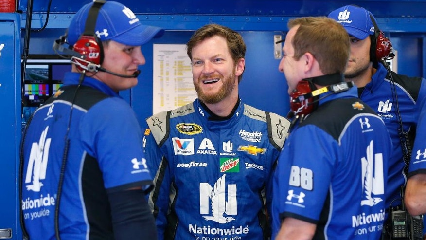 Dale Earnhardt Jr., second from left, chats with his crew in the garage during NASCAR Sprint Cup auto racing practice at Daytona International Speedway, Thursday, June 30, 2016, in Daytona Beach, Fla. (AP Photo/Wilfredo Lee)