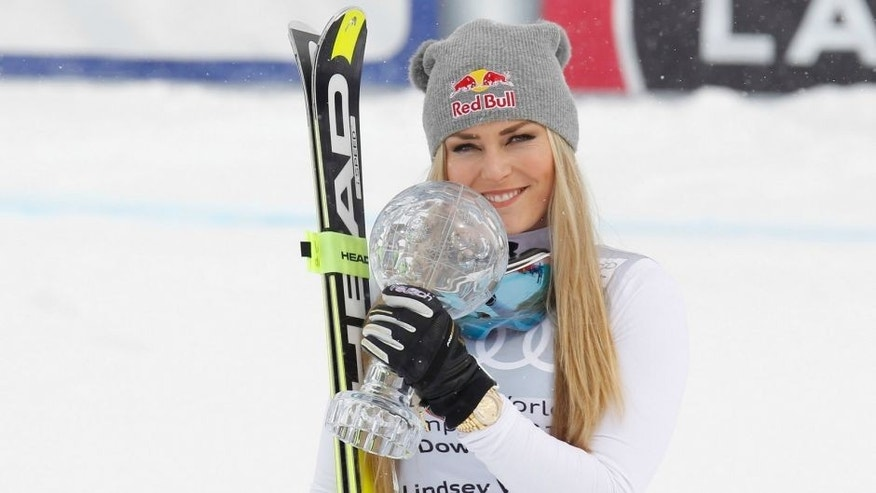 ST MORITZ, SWITZERLAND - MARCH 16: Lindsey Vonn of The USA poses with the crystal globe for overall downhill during the Audi FIS Alpine Skiing World Cup downhill on March 16, 2016 in St Moritz, Switzerland. (Photo by Mitchell Gunn/Getty Images)