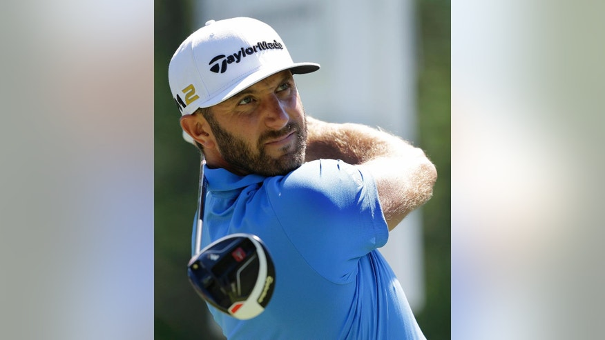 Dustin Johnson tees off the ninth hole during the first round of the Bridgestone Invitational golf tournament at Firestone Country Club, Thursday, June 30, 2016, in Akron, Ohio. (AP Photo/Tony Dejak)