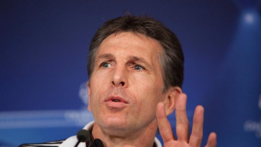 FILE - This is a Tuesday, March 15, 2011 file photo of  the then  coach of Lyon Claude Puel as he gestures during a press conference in Madrid. English Premier League team Southampton Thursday June 30, 2016 hired Claude Puel as managerafter being impressed by his command of French side Nice. (AP Photo/Arturo Rodriguez, File)