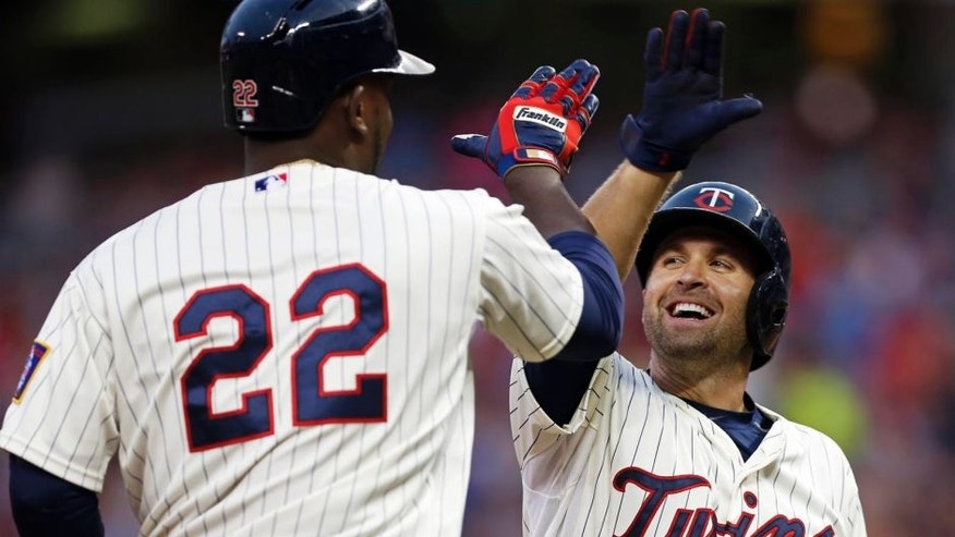 Wednesday, August 12: The Minnesota Twins' Miguel Sano (left) is congratulated by Brian Dozier after Sano's two-run home run off Texas Rangers pitcher Nick Martinez during the third inning in Minneapolis.
