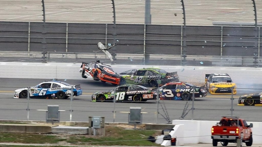 Austin Dillon (2) wrecks with Justin Marks (42) in the backstretch as Darrell Wallace Jr. (6), David Ragan (18) and Ty Dillon (3) try to get by during a NASCAR Xfinity Series auto race at Daytona International Speedway, Friday, July 1, 2016, in Daytona Beach, Fla. (AP Photo/David Graham)