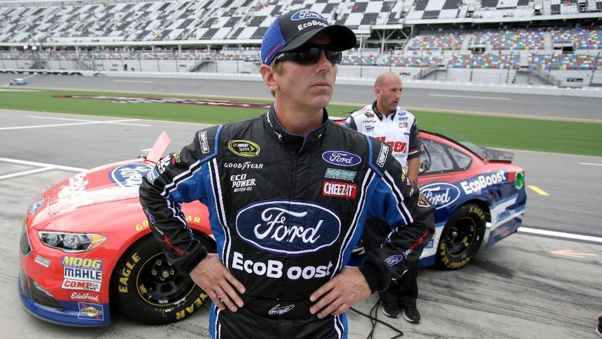 CORRECTS TO QUALIFIED, NOT THE POLE - Greg Biffle looks up at the scoring monitor after he qualified for Saturday night's NASCAR Sprint Cup auto race at Daytona International Speedway, Friday, July 1, 2016, in Daytona Beach, Fla. (AP Photo/John Raoux)