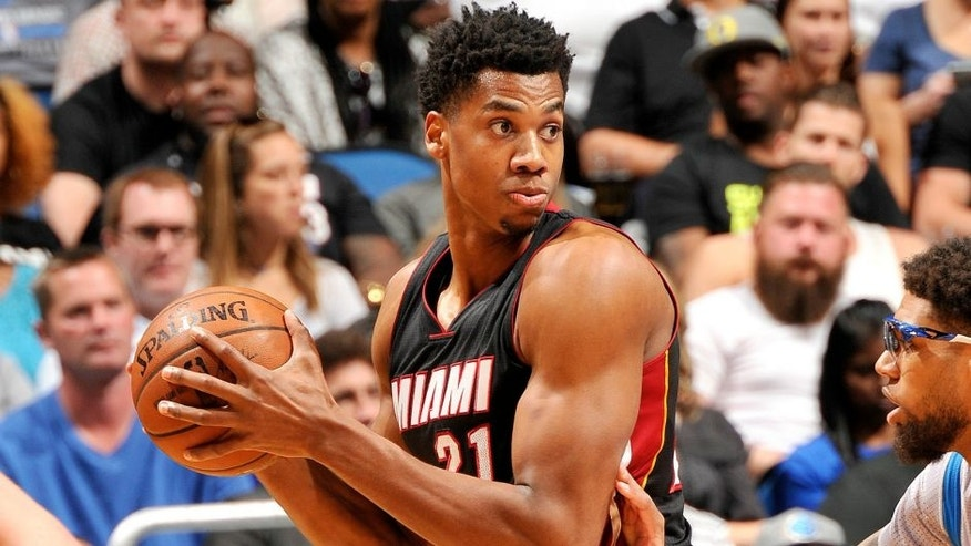 ORLANDO, FL - APRIL 8: Hassan Whiteside #21 of the Miami Heat handles the ball during the game against the Orlando Magic on April 8, 2016 at Amway Center in Orlando, Florida. NOTE TO USER: User expressly acknowledges and agrees that, by downloading and or using this photograph, User is consenting to the terms and conditions of the Getty Images License Agreement. Mandatory Copyright Notice: Copyright 2016 NBAE (Photo by Fernando Medina/NBAE via Getty Images)