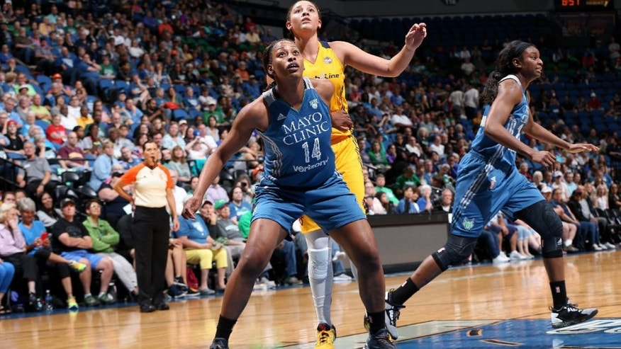 Bashaara Graves of the Minnesota Lynx boxes out against Natalie Achonwa of the Indiana Fever.