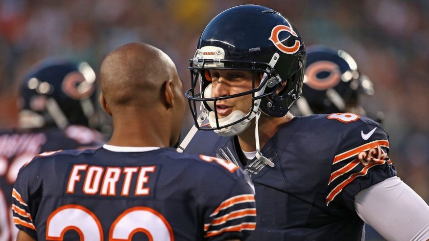 CHICAGO, IL - AUGUST 13: Jay Cutler #6 of the Chicago Bears talks with Matt Forte #22 during a preseason game against the Miami Dolphins at Soldier Field on August 13, 2015 in Chicago, Illinois. (Photo by Jonathan Daniel/Getty Images)
