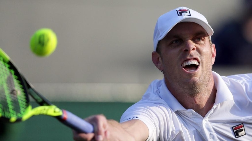 Sam Querrey of the U.S returns to Novak Djokovic of Serbia during their men's singles match on day five of the Wimbledon Tennis Championships in London, Friday, July 1, 2016. (AP Photo/Tim Ireland)