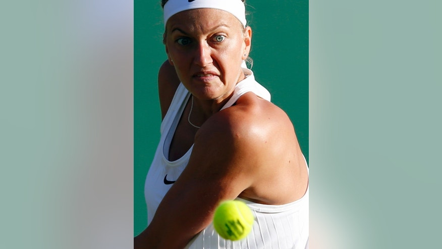 Petra Kvitova of the Czech Republic returns to Ekaterina Makarova of Russia during their women's singles match on day five of the Wimbledon Tennis Championships in London, Friday, July 1, 2016. (AP Photo/Alastair Grant)