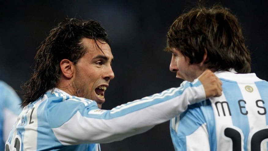 Football - Argentina v Mexico FIFA World Cup Second Round - South Africa 2010 - Soccer City Stadium, Johannesburg, South Africa - 27/6/10 Carlos Tevez celebrates with Lionel Messi (R) after scoring Argentina's first goal Mandatory Credit: Action Images / Andrew Boyers Livepic