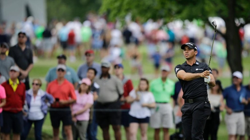 Jason Day, from Australia, hits to the second green during the third round of the Bridgestone Invitational golf tournament at Firestone Country Club, Saturday, July 2, 2016, in Akron, Ohio. (AP Photo/Tony Dejak)
