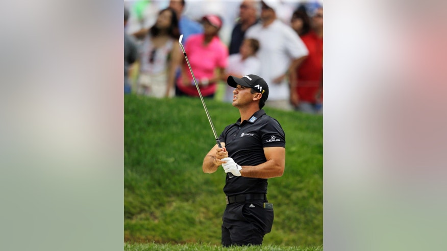Jason Day, from Australia, watches his ball after hitting out of a sand trap on the second hole during the third round of the Bridgestone Invitational golf tournament at Firestone Country Club, Saturday, July 2, 2016, in Akron, Ohio. (AP Photo/Tony Dejak)
