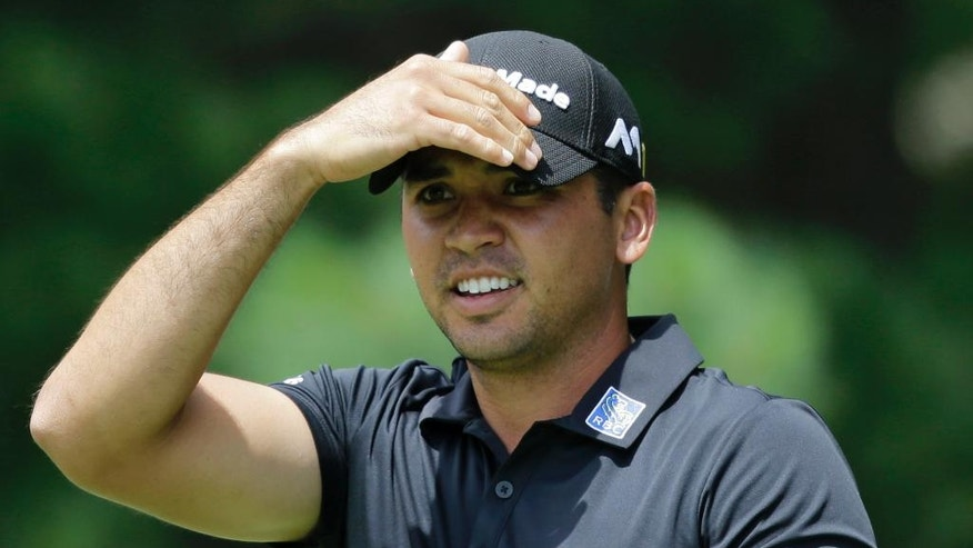 Jason Day, from Australia, watches his tee shot from the second tee during the third round of the Bridgestone Invitational golf tournament at Firestone Country Club, Saturday, July 2, 2016, in Akron, Ohio. (AP Photo/Tony Dejak)