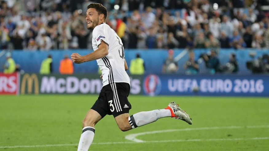Germany's Jonas Hector celebrates after scoring the winning penalty during the Euro 2016 quarterfinal soccer match between Germany and Italy, at the Nouveau Stade in Bordeaux, France, Saturday, July 2, 2016. Germany beat Italy 6-5 in a penalty shootout. (AP Photo/Antonio Calanni)