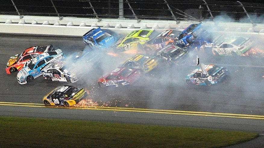 Martin Truex Jr. (78), Greg Biffle (16), Jimmie Johnson (48) and Jamie McMurray (1) are at the head of a multi-car accident between Turns 1 and 2 at Daytona International Speedway during a NASCAR Sprint Cup auto race, Saturday, July 2, 2016, in Daytona Beach, Fla. (AP Photo/Phelan M. Ebenhack)