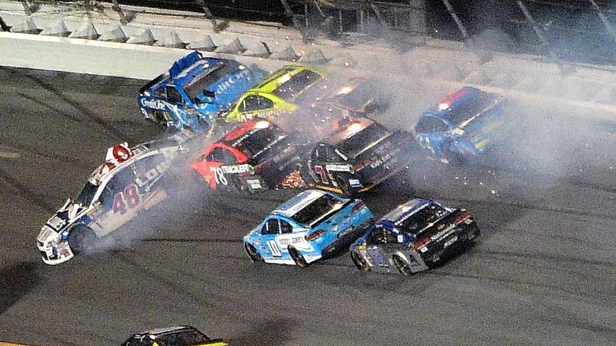 Jamie McMurray (1) and Jimmie Johnson (48) begin a multi-car accident in Turn 1 of Daytona International Speedway during a NASCAR Sprint Cup auto race, Saturday, July 2, 2016, in Daytona Beach, Fla. (AP Photo/Phelan M. Ebenhack)