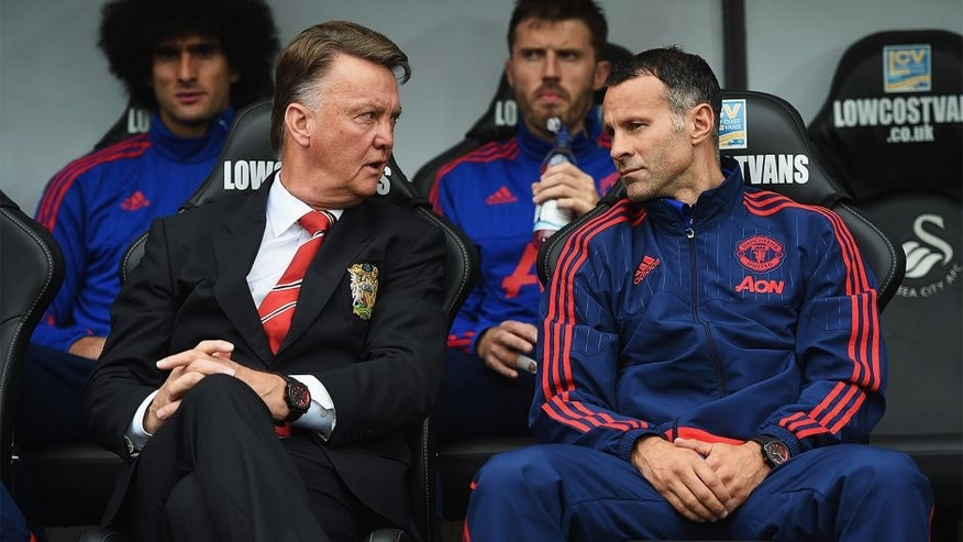 SWANSEA, WALES - AUGUST 30: Louis van Gaal, manager of Manchester United talks to assistant Ryan Giggs during the Barclays Premier League match between Swansea City and Manchester United at Liberty Stadium on August 30, 2015 in Swansea, Wales. (Photo by Michael Regan/Getty Images)