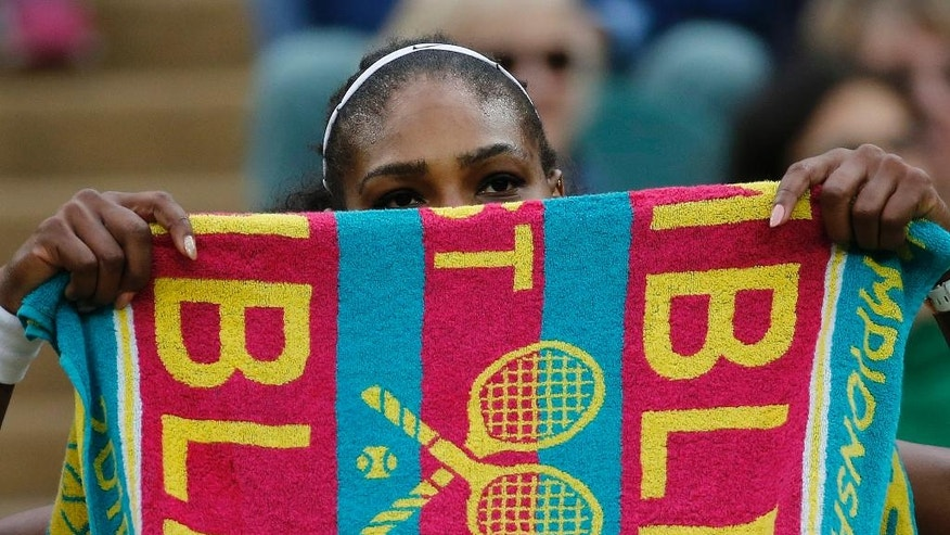 Serena Williams of the U.S holds up a towel during a break in her women's singles match against Christina McHale of the U.S on day five of the Wimbledon Tennis Championships in London, Friday, July 1, 2016. (AP Photo/Ben Curtis)
