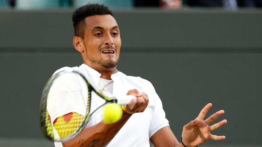 Nick Kyrgios of Australia returns to Feliciano Lopez of Spain during their men's singles match on day six of the Wimbledon Tennis Championships in London, Saturday, July 2, 2016. (AP Photo/Alastair Grant)