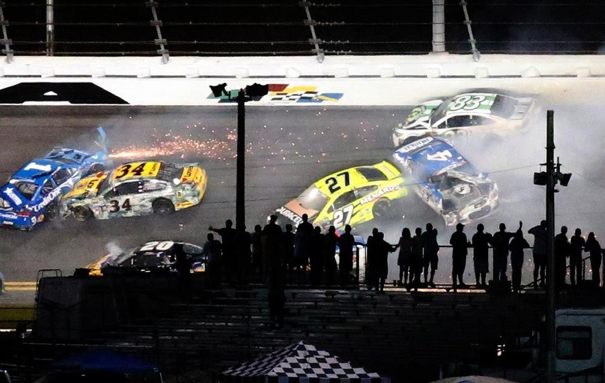Several cars are involved in a crash in Turn 1 during the NASCAR Sprint Cup auto race at Daytona International Speedway, Saturday, July 2, 2016, in Daytona Beach, Fla. (AP Photo/Wilfredo Lee)