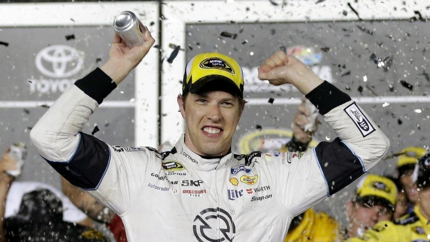 Brad Keselowski celebrates in Victory Lane.