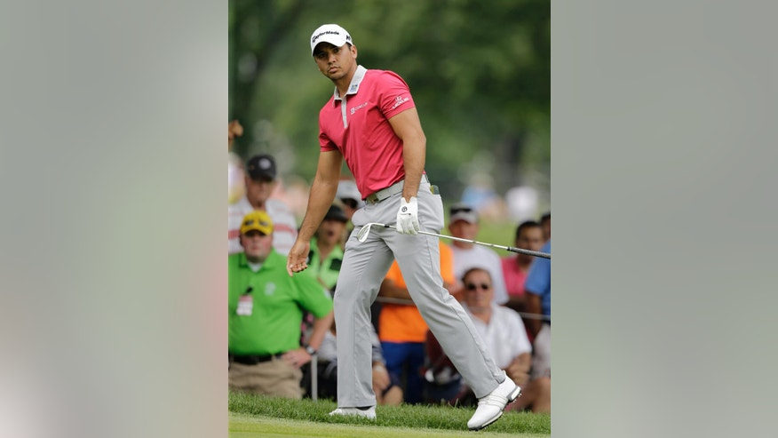 Jason Day, from Australia, watches his eagle shot on the second hole during the final round of the Bridgestone Invitational golf tournament at Firestone Country Club, Sunday, July 3, 2016, in Akron, Ohio. (AP Photo/Tony Dejak)