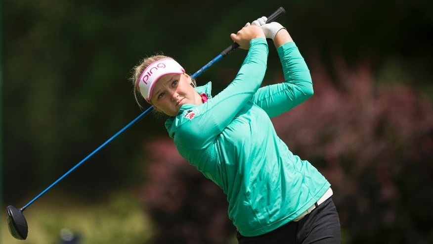Brooke Henderson, of Canada, hits a tee shot on the third hole during the final round of the LPGA Cambia Portland Classic golf tournament Sunday, July 3, 2016, in Portland, Ore. (AP Photo/Troy Wayrynen)