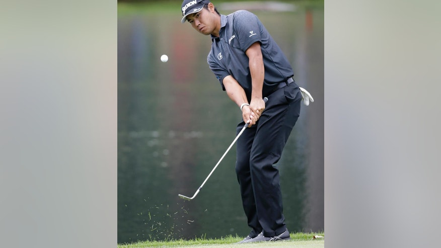 Hideki Matsuyama, from Japan, chips to the third green during the second round of the Bridgestone Invitational golf tournament at Firestone Country Club, Friday, July 1, 2016, in Akron, Ohio. (AP Photo/Tony Dejak)