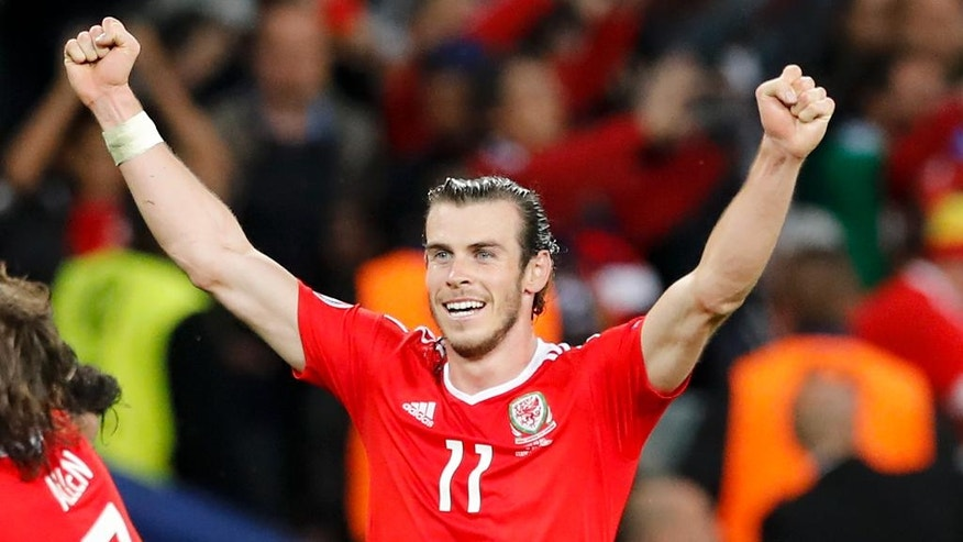 Wales' Gareth Bale celebrates his side's 3-1 win at the end of the Euro 2016 quarterfinal soccer match between Wales and Belgium, at the Pierre Mauroy stadium in Villeneuve d'Ascq, near Lille, France, Friday, July 1, 2016. (AP Photo/ Michel Spingler)