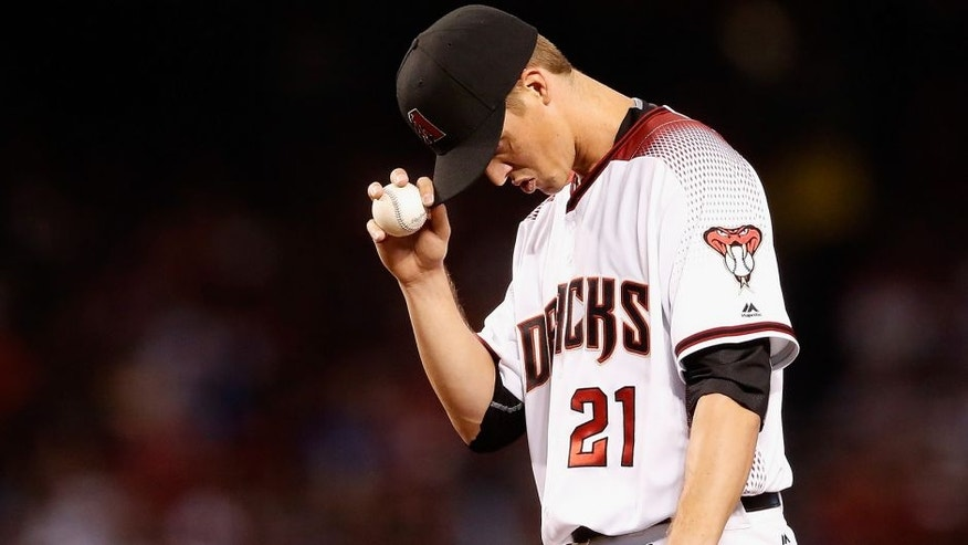 <p>PHOENIX, AZ - APRIL 04: Starting pitcher Zack Greinke #21 of the Arizona Diamondbacks prepares to pitch against the Colorado Rockies during the second inning of the MLB opening day game at Chase Field on April 4, 2016 in Phoenix, Arizona. (Photo by Christian Petersen/Getty Images)</p>