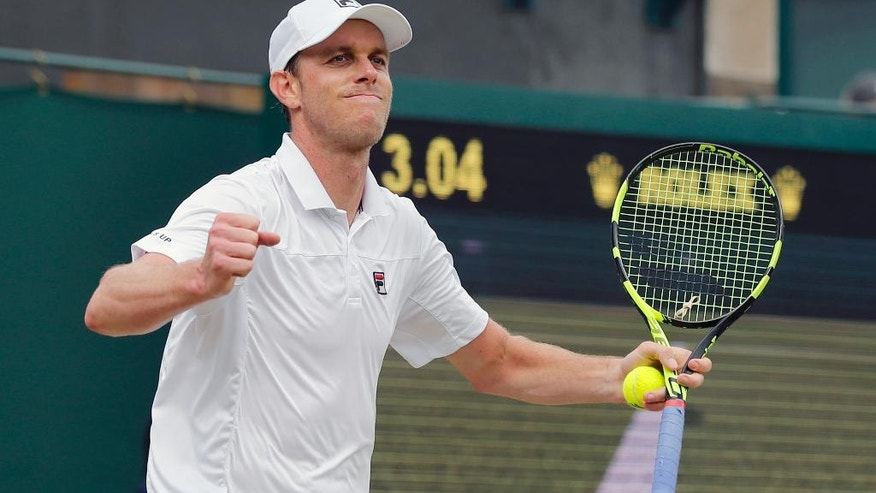 Sam Querrey of the U.S celebrates after beating Nicolas Mahut of France in their men's singles match on day eight of the Wimbledon Tennis Championships in London, Monday, July 4, 2016. (AP Photo/Ben Curtis)