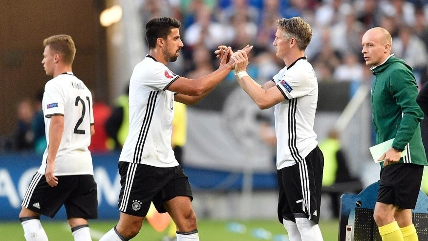 Germany's Bastian Schweinsteiger, center right, replaces teammate Sami Khedira on the pitch during the Euro 2016 quarterfinal soccer match between Germany and Italy, at the Nouveau Stade in Bordeaux, France, Saturday, July 2, 2016. (AP Photo/Martin Meissner)
