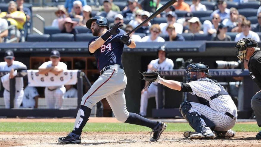 Jun 26, 2016; Bronx, NY, USA; Minnesota Twins third baseman Trevor Plouffe (24) hits a home run to left during the sixth inning against the New York Yankees at Yankee Stadium. Mandatory Credit: Anthony Gruppuso-USA TODAY Sports
